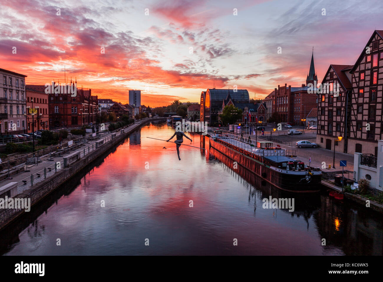 Poland, Kuyavian-Pomeranian, Bydgoszcz, Brda River, Dramatic sky reflecting in water surface - Stock Image