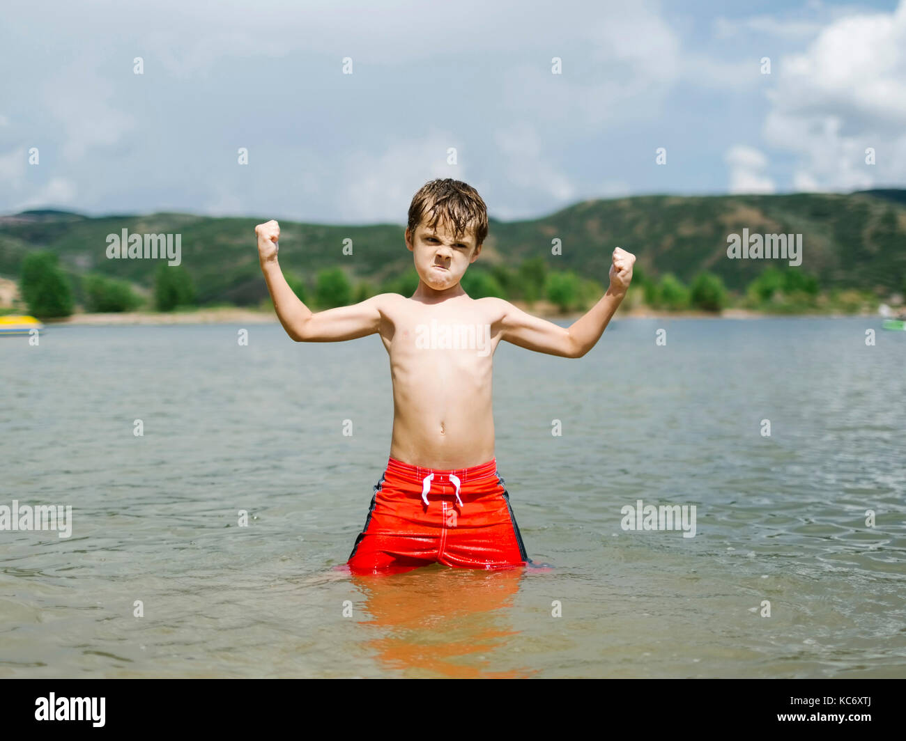 Boy Flexing Muscles Stock Photos Amp Boy Flexing Muscles