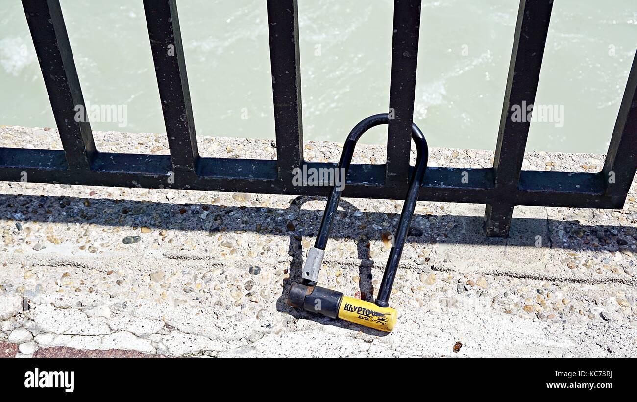 Keys and padlock at the bridge across Inn River in Innsbruck, Austria - Stock Image