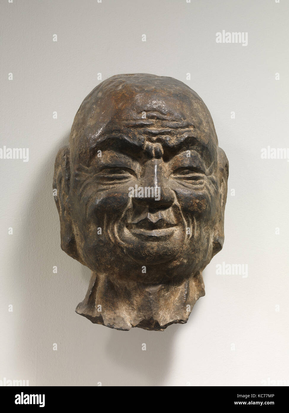 Head of Arhat, Tang dynasty (618–907), 8th–9th century, China, Limestone with traces of pigment, H. 21 in. (53.3 - Stock Image