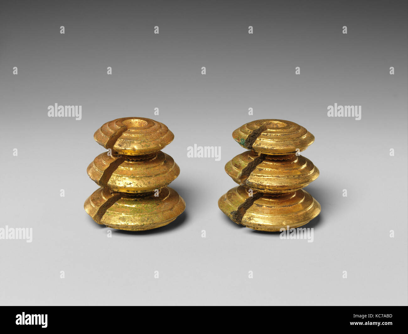 Pair of Weighted Fasteners, Central Javanese period, 8th–early 10th century, Indonesia (Java), Gold, Overall (each): - Stock Image