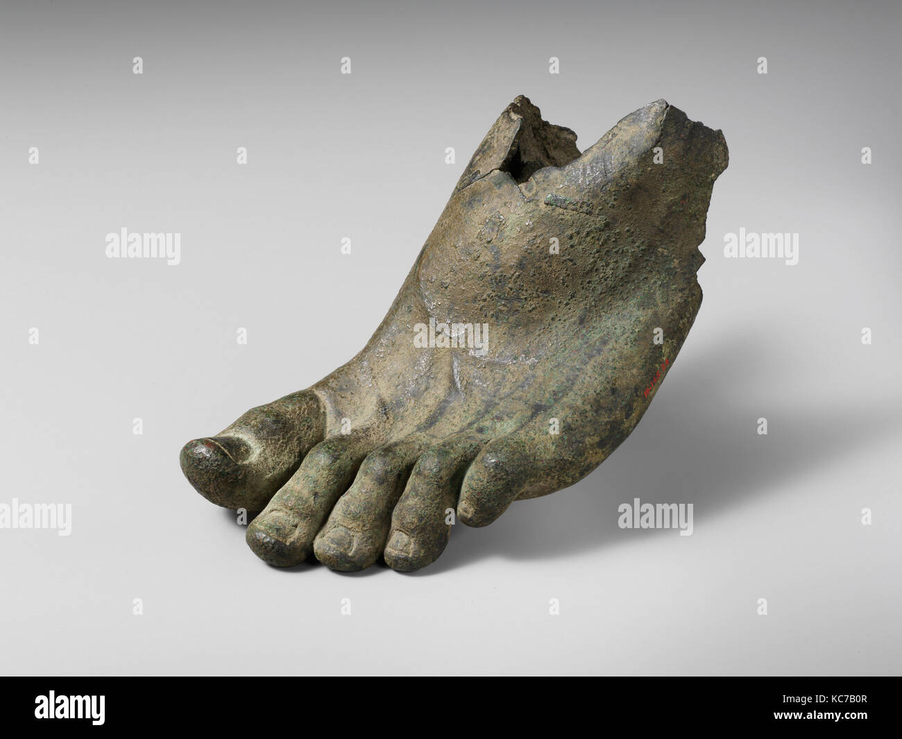 Bronze left foot with traces of sandal straps, 1st or 2nd century A.D - Stock Image