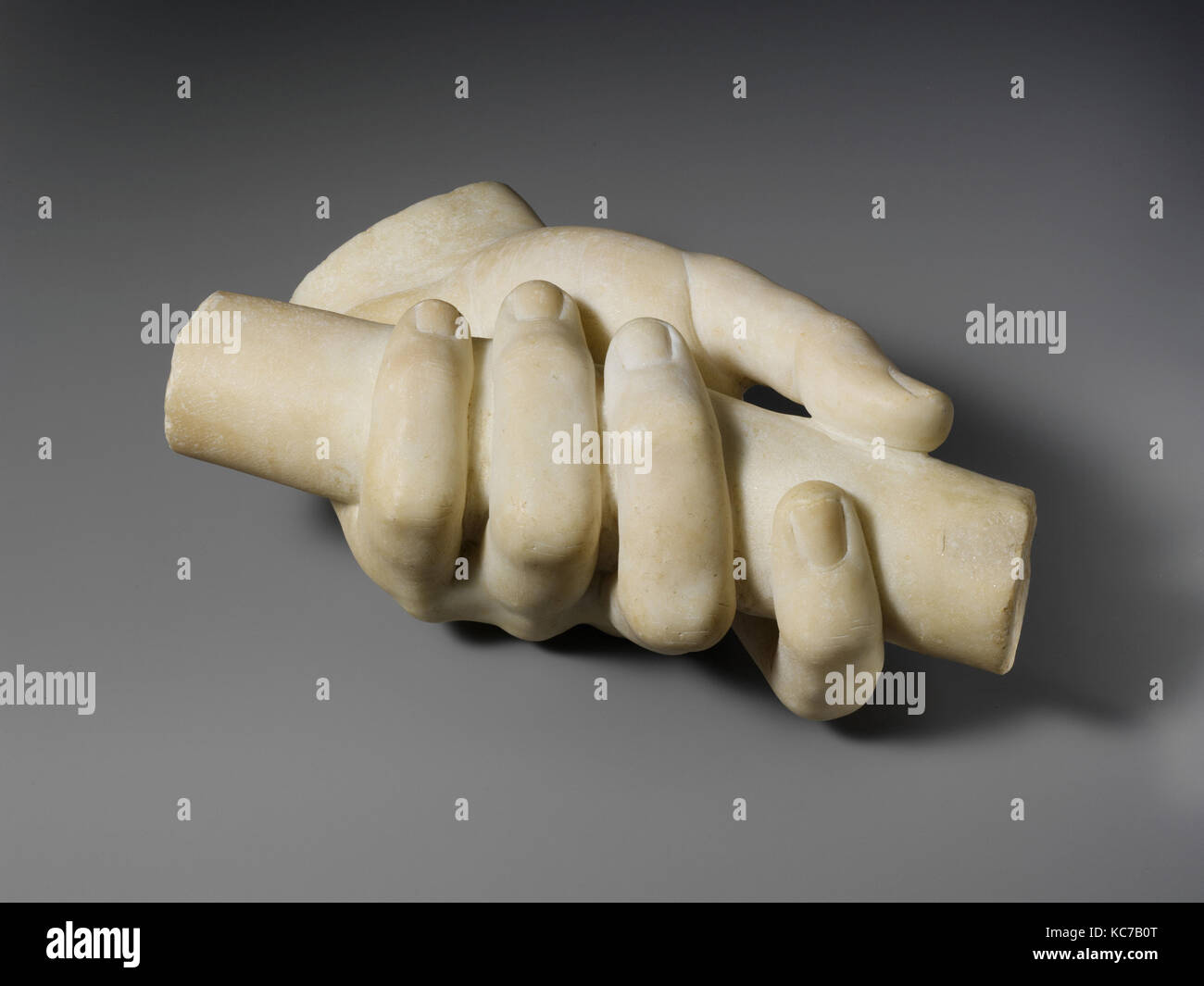 Marble left hand holding a scroll, 1st or 2nd century A.D - Stock Image