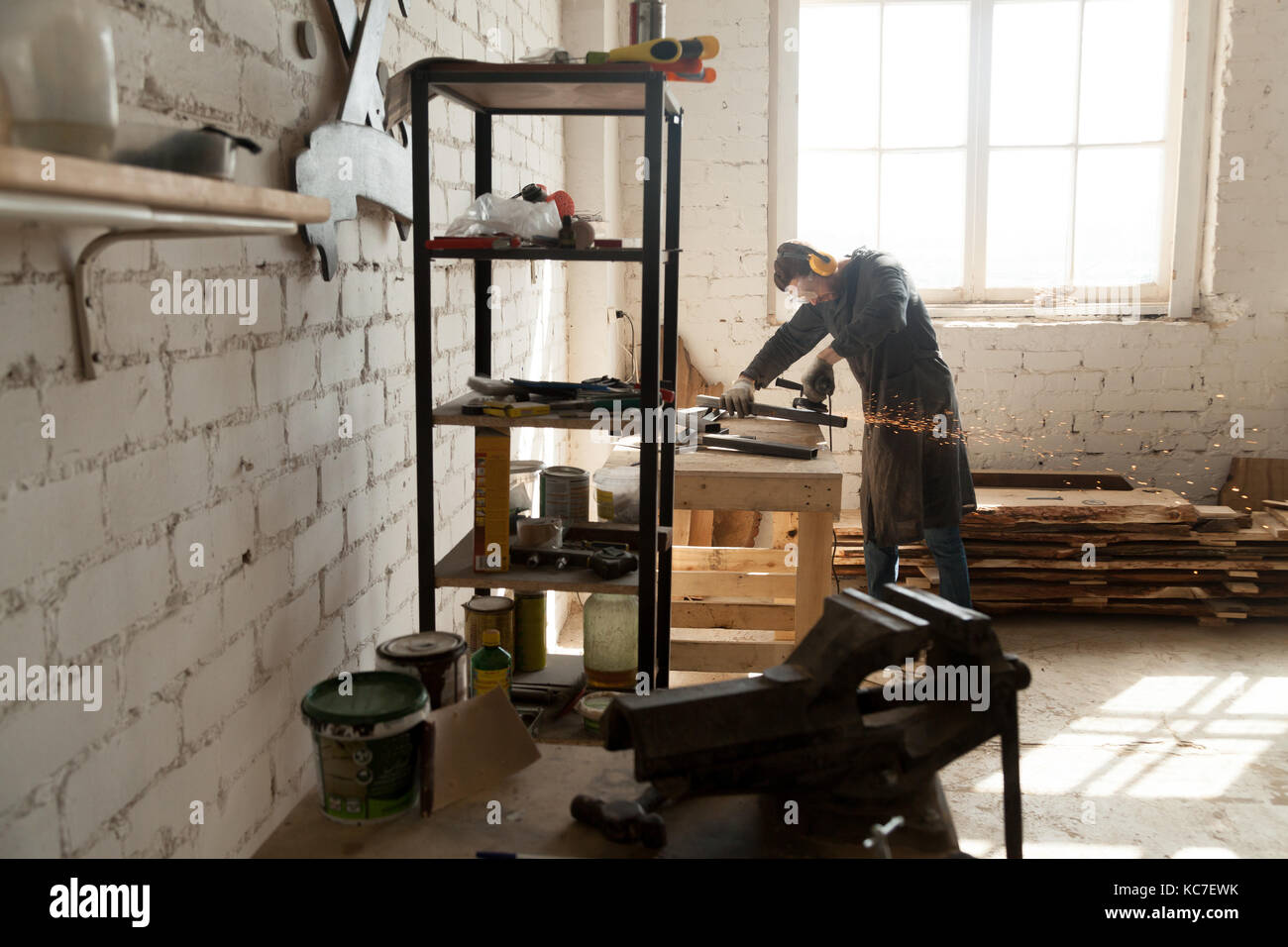 Skilled cabinet maker working in small workshop - Stock Image