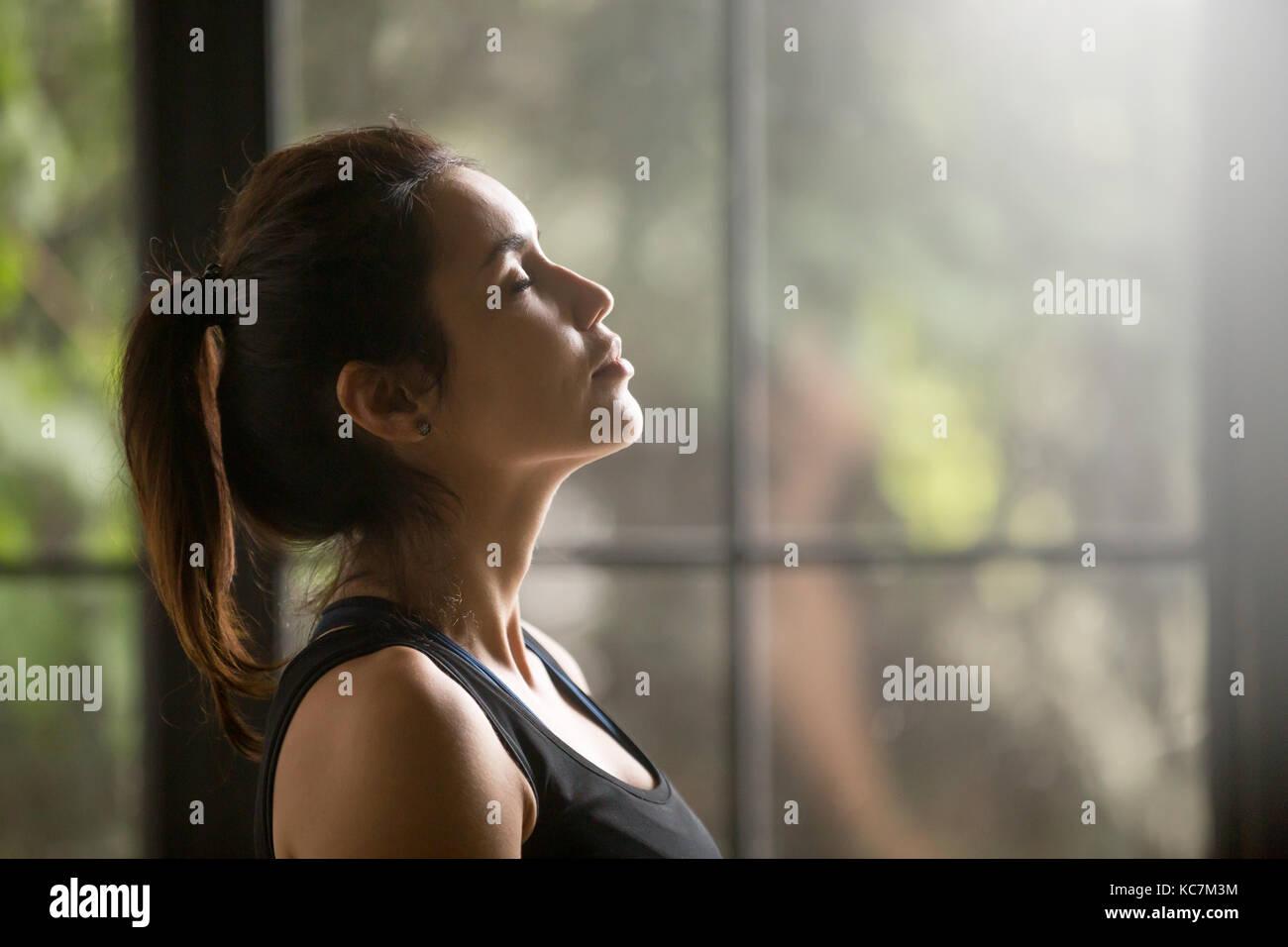 Profile portrait of young attractive yogi woman - Stock Image