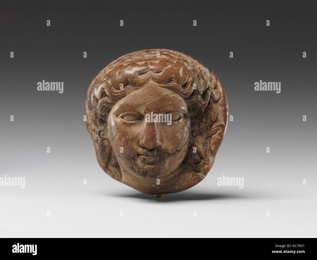 Head of Dionysus (?) for attachment, possibly for a couch, 332–30 B.C - Stock Image