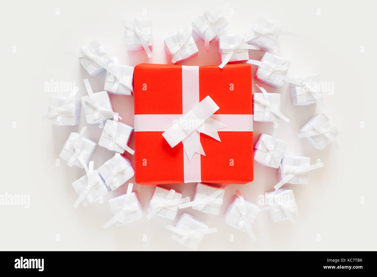 A Lot Of Small Gift Boxes One Red Big Present Stock Photo