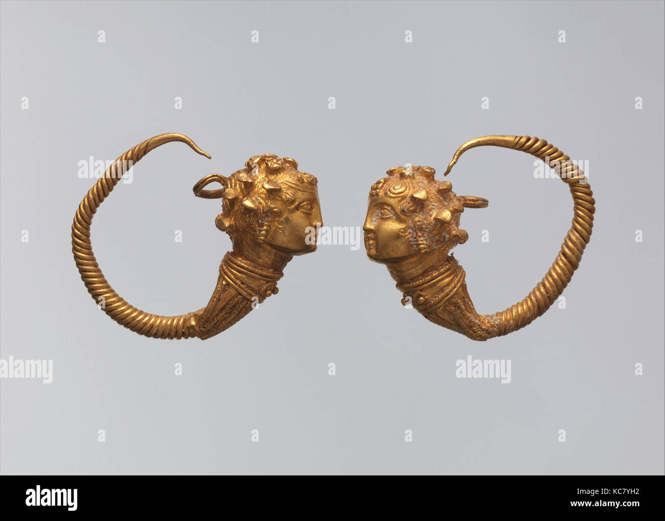 Maenad-head earrings, Ptolemaic Period, 1st century B.C., From Egypt, gold, a. As Worn: H. 2.5 × W. 2.9 cm (1 × Stock Photo