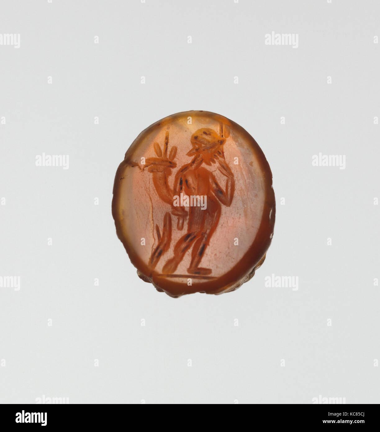 Carnelian scarab: Harpocrates with cornucopia, 2nd century A.D - Stock Image