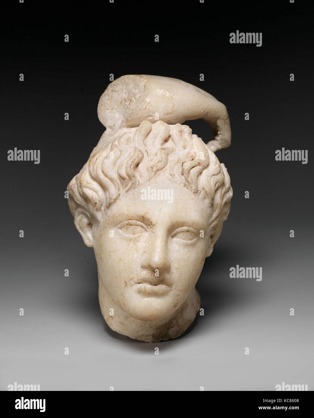 Marble head of Apollo with fragment of his hand, 1st or 2nd century A.D - Stock Image