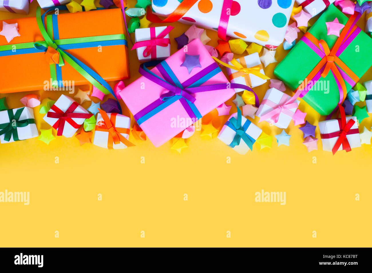 Colored Gift Boxes With Colorful Ribbons Yellow Background Gifts