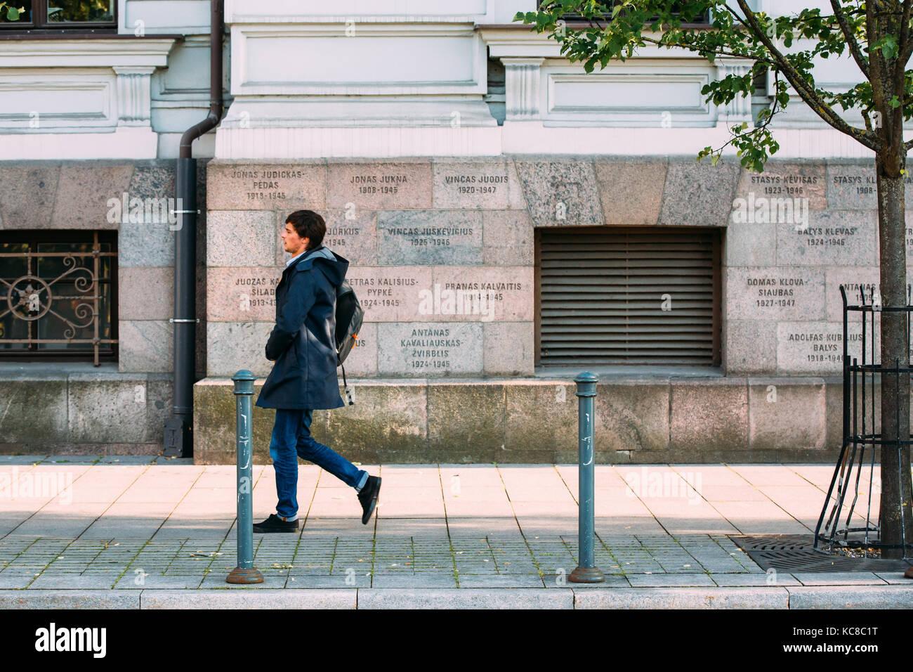Vilnius, Lithuania - July 7, 2016: Young Man Walking Past Wall Of Museum Of Genocide Victims Located In Former KGB - Stock Image