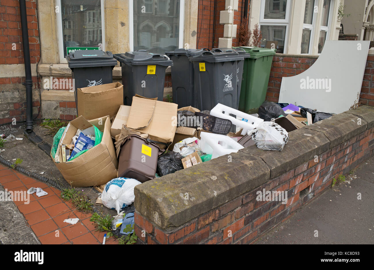 Rubbish awaiting collection at end of academic year from front garden of house formerly occupied by students, Cardiff, - Stock Image