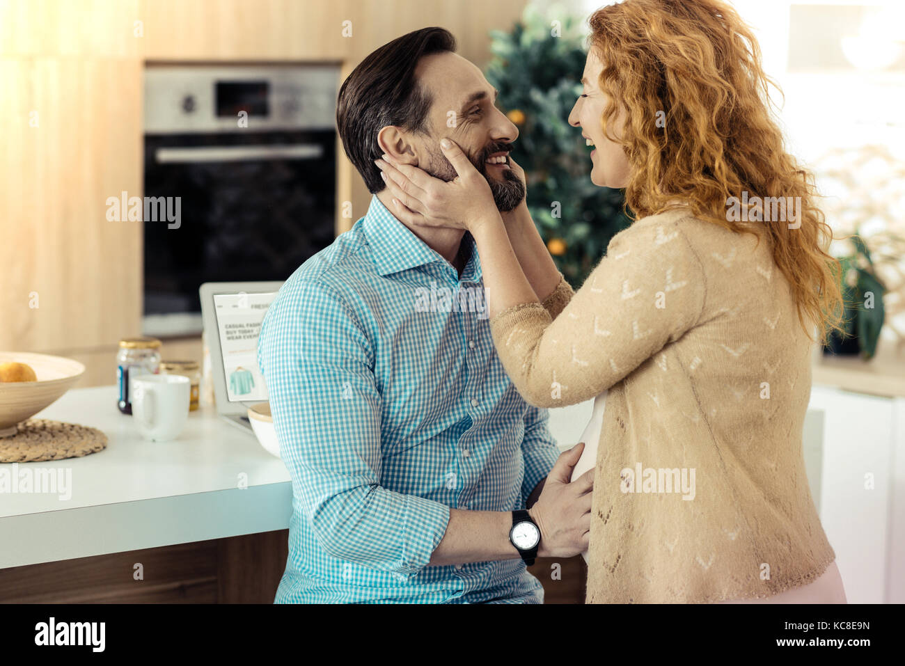Adorable woman touching her husbands face - Stock Image