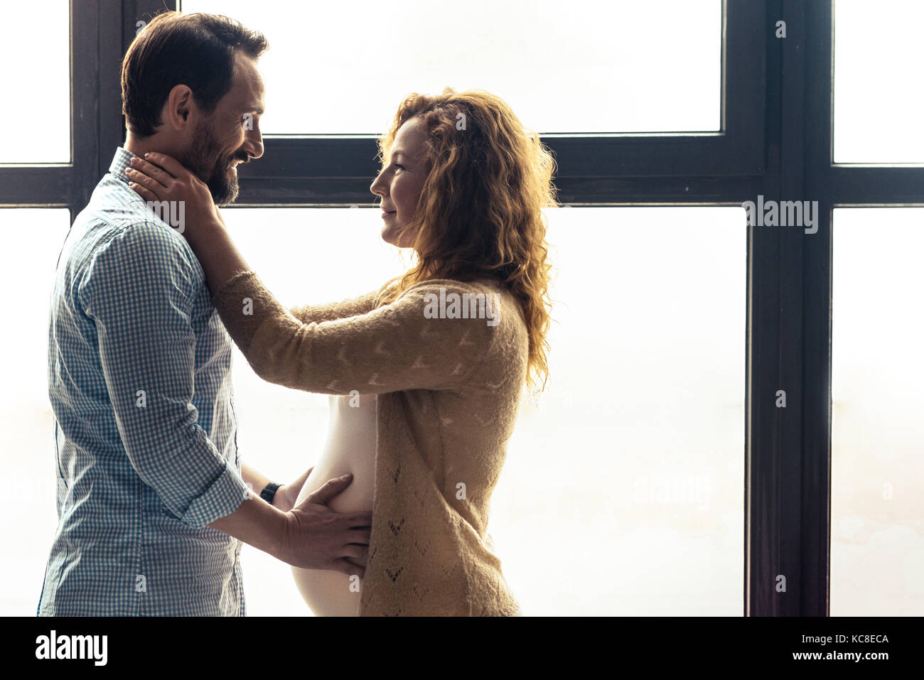 Beloved couple looking at each other - Stock Image