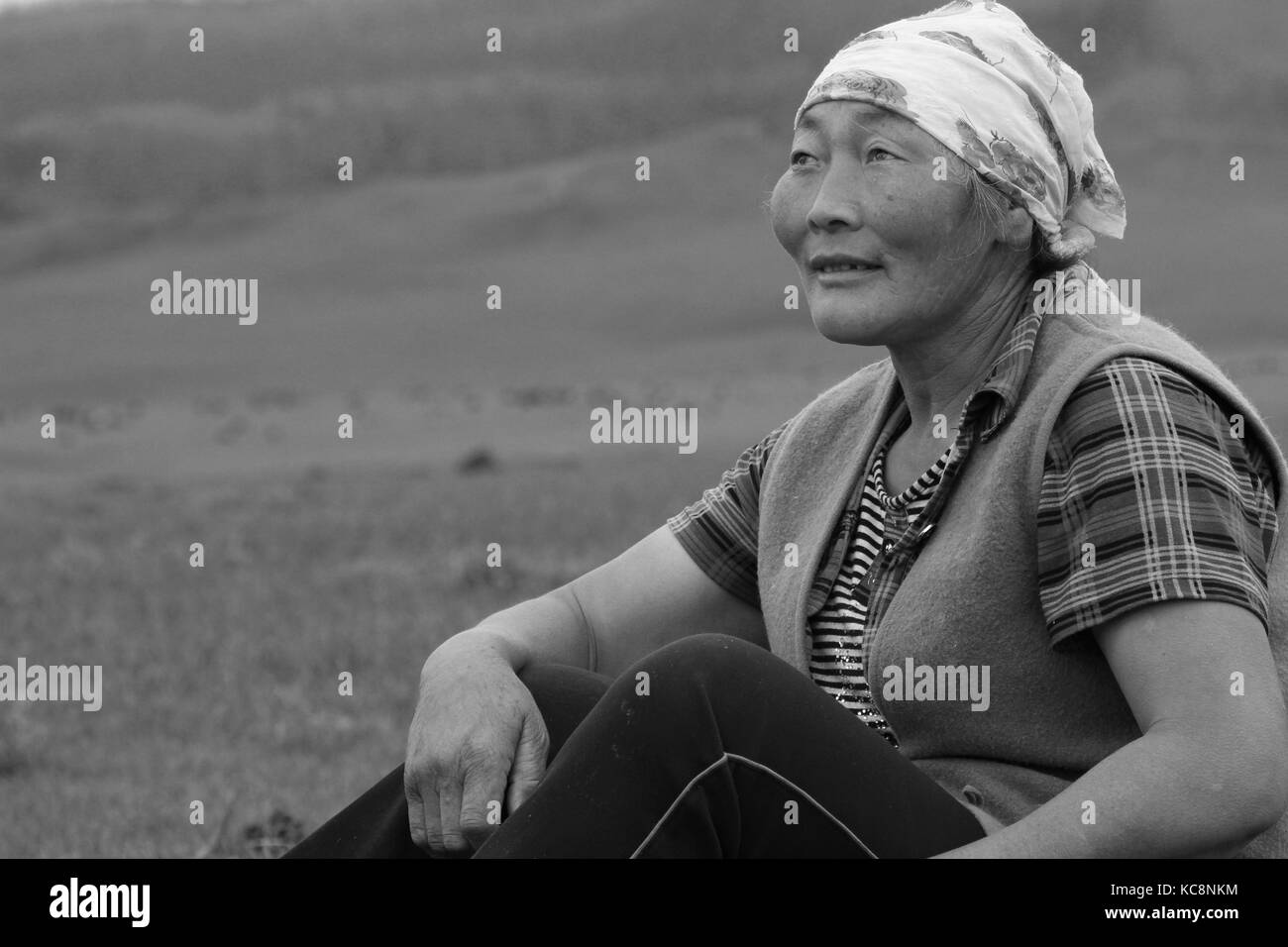 BAT-ULZII, MONGOLIA - JULY, 14, 2013 - A mongolian woman in the steppe. Half of mongolian population has a nomadic - Stock Image