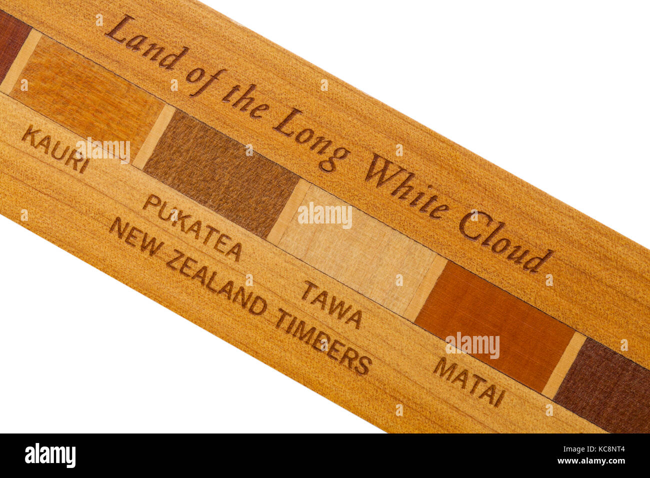 Land of the long white cloud - detail of part of wooden ruler made with New Zealand timbers, woods shown are (left - Stock Image