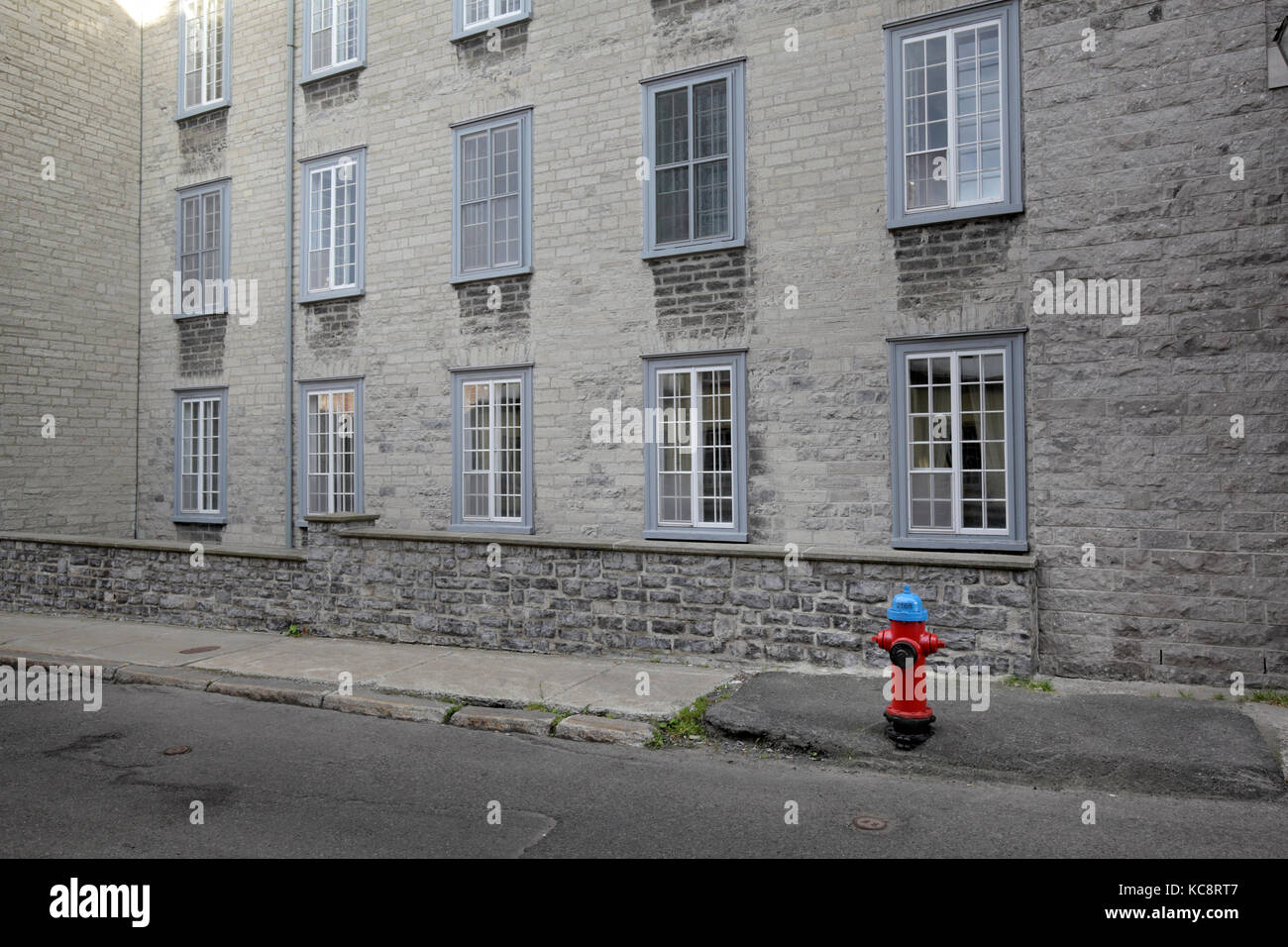 house with fire hydrant in Québec City, Canada - Stock Image