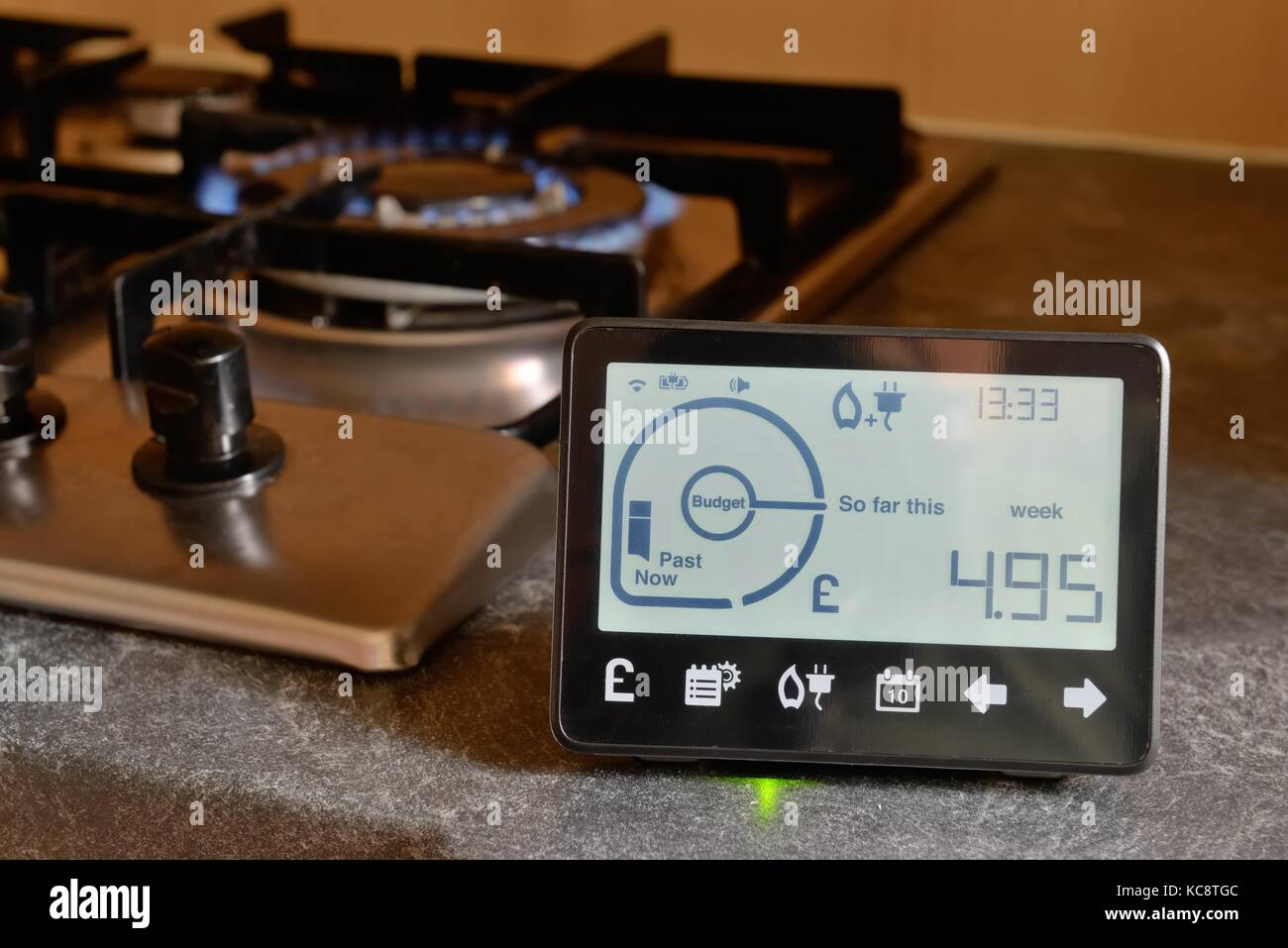In-home display unit showing energy usage for gas and electricity in a UK house. - Stock Image