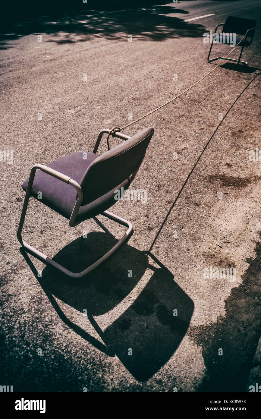 Two chairs and rope mark out street parking space on Prado central Havana, Cuba. Stock Photo