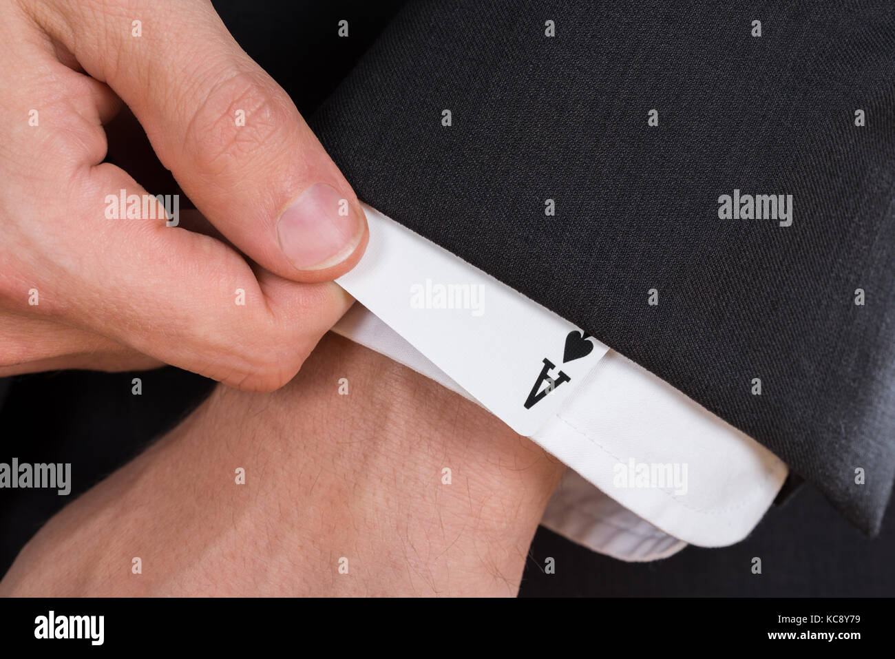 Business card trick executive stock photos business card trick close up of businessman hand removing ace card from sleeve stock image colourmoves