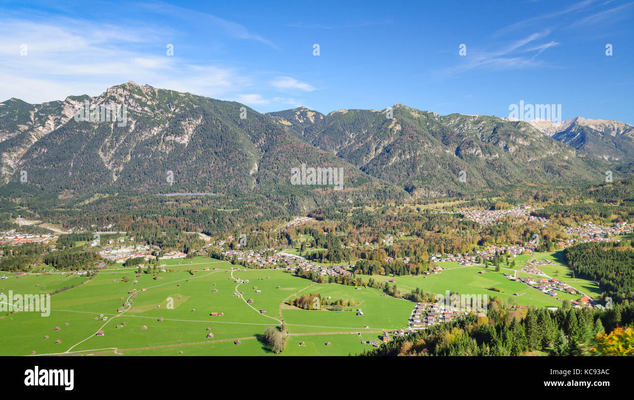 Aerial landscape with fresh green grazing meadow in Bavarian Alpine valley - Stock Image