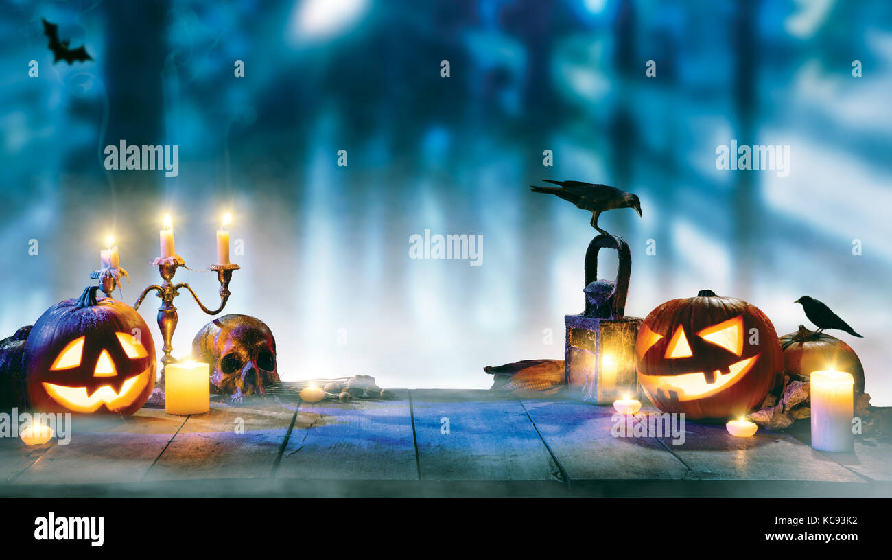 Spooky halloween pumpkins on wooden planks with dark horror