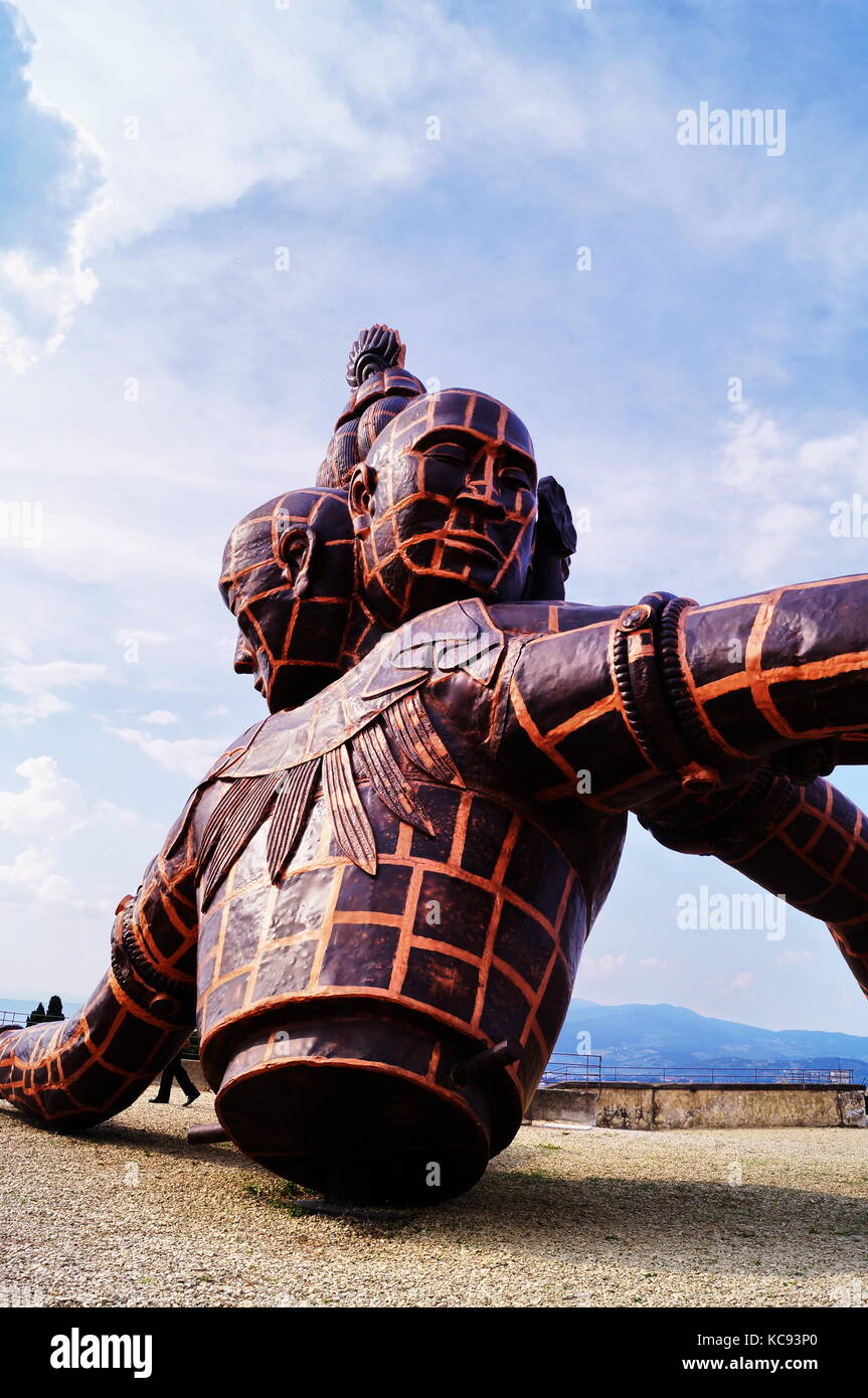The sculpture entitled Three Heads Six Arms by Chinese artist Zhang Huan located in Forte di Belvedere Florence Italy Stock Photo