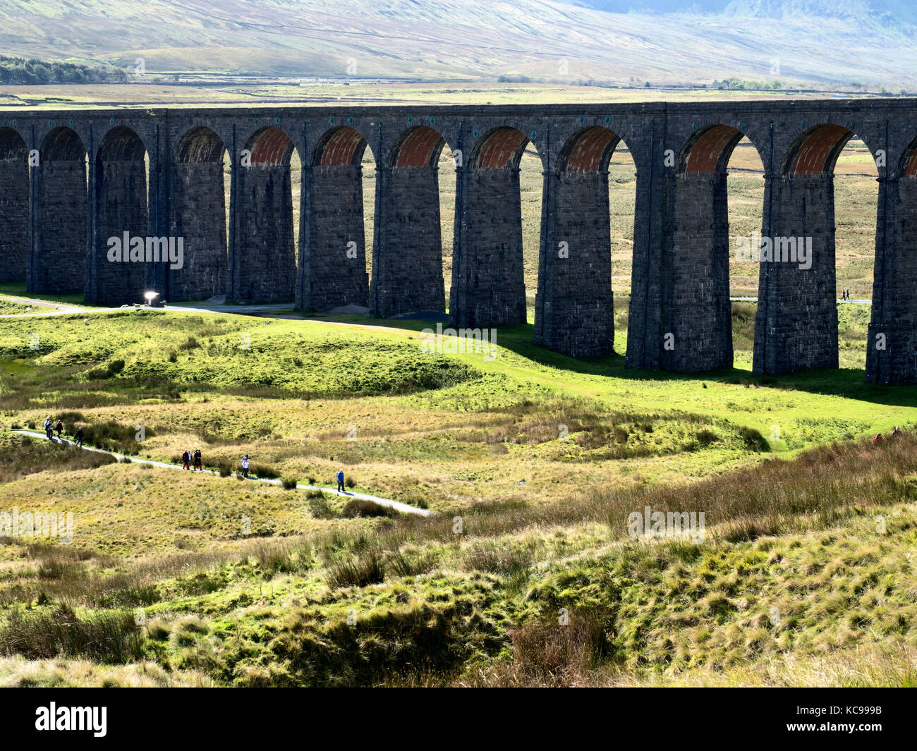 Walkers on a Path under the Ribblehead Viaduct Yorkshire Dales England - Stock Image