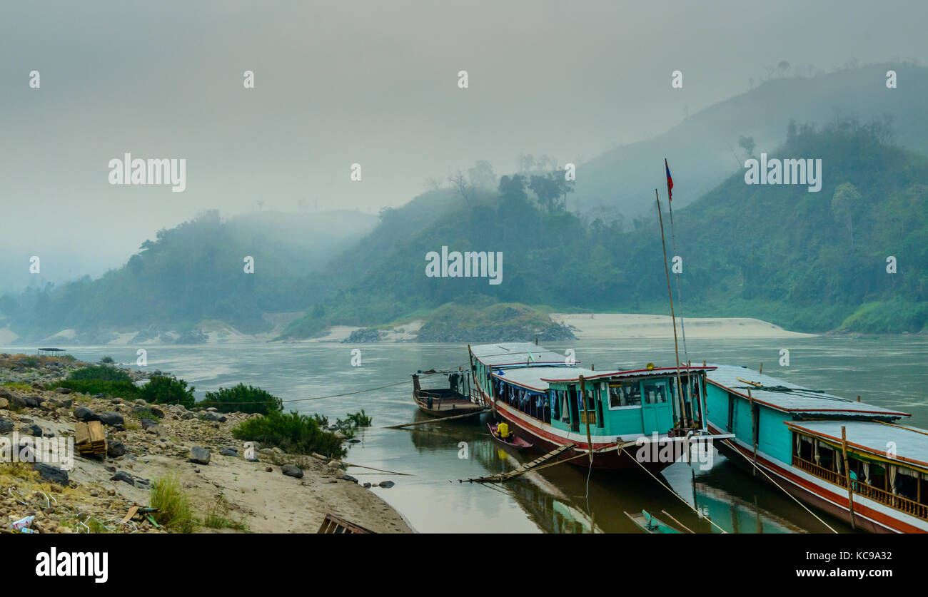 Slow Boat Docked on the bank of the Mekong - Early Morning, Loas, Asia Stock Photo
