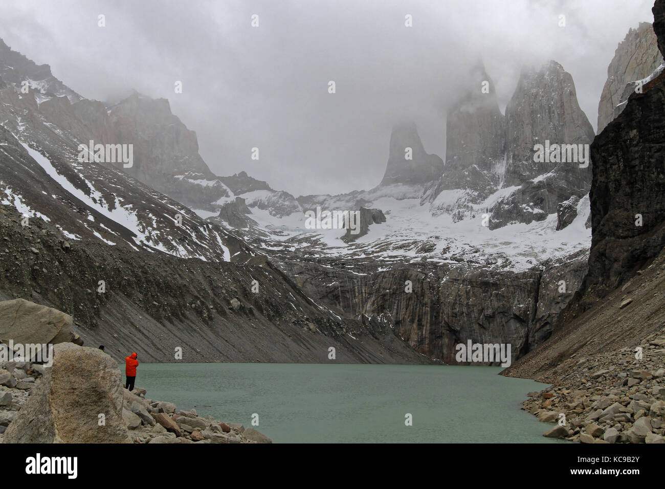 PAINE, CHILE, December 29, 2013 : Three towers of Torres del Paine over the lake - Stock Image