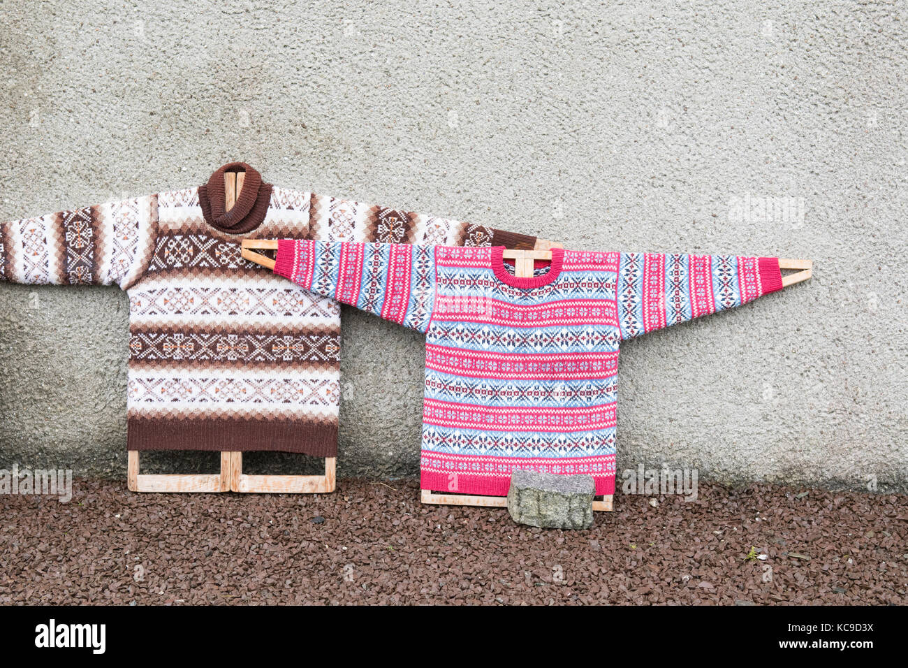 Fair Isle knitted jumpers on jumper boards outside Shetland Textile Museum, Bod of Gremista, Lerwick, Shetland islands, - Stock Image
