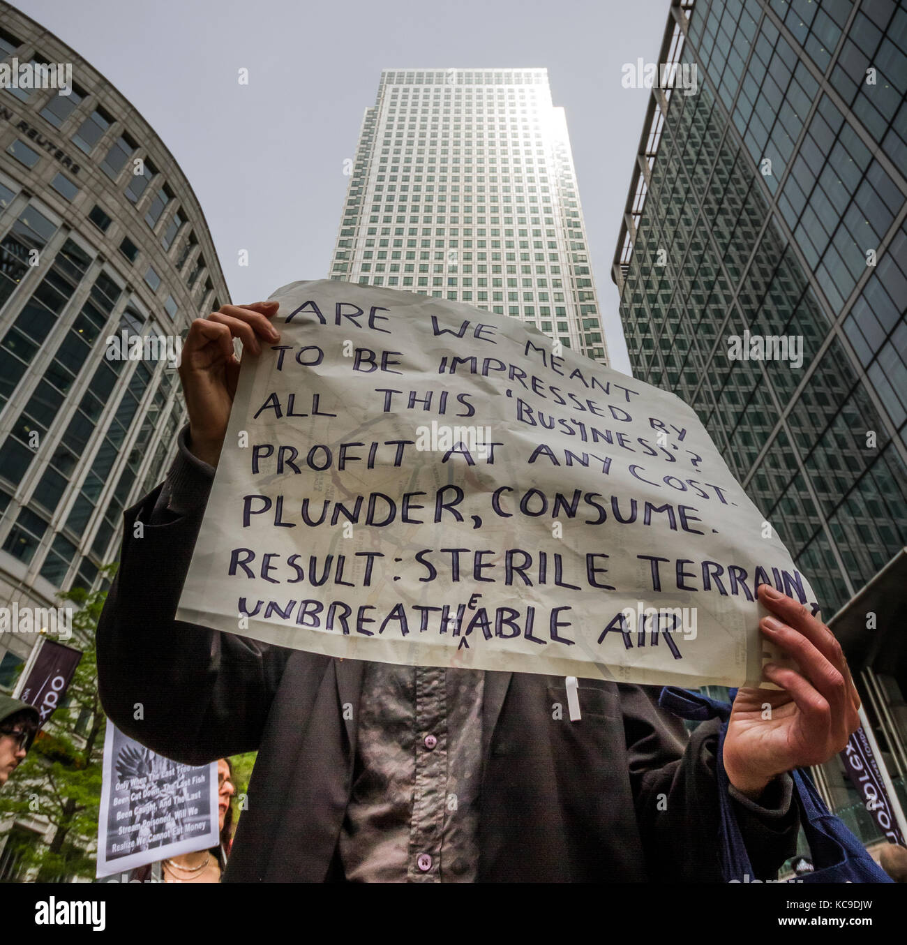 'They Owe Us' protest at Canary Wharf in east London sees climate activists join anti-capitalists to occupy one Stock Photo