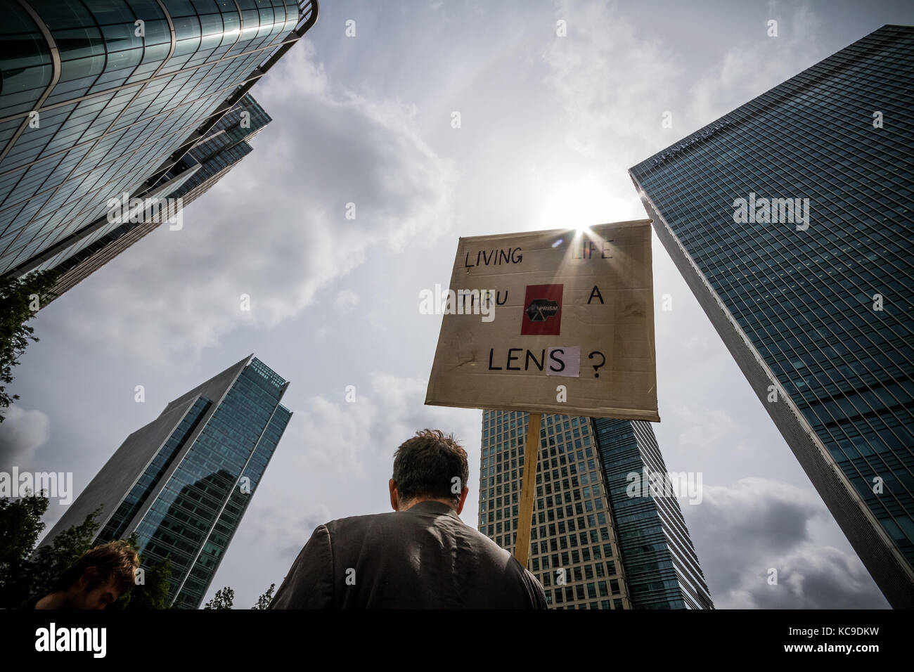 'They Owe Us' protest at Canary Wharf in east London sees climate activists join anti-capitalists to occupy one - Stock Image
