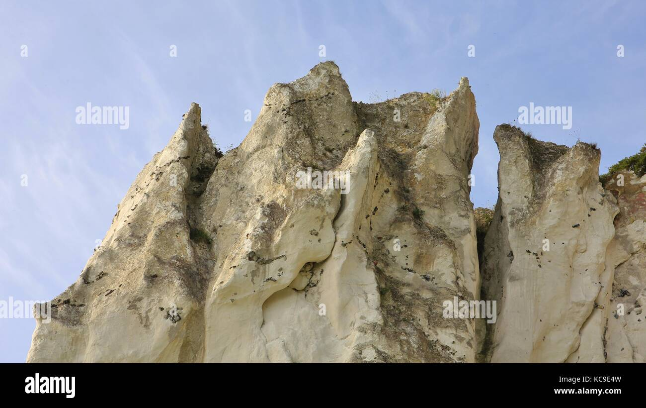 Chalk rock shaped by wind and weather. - Stock Image