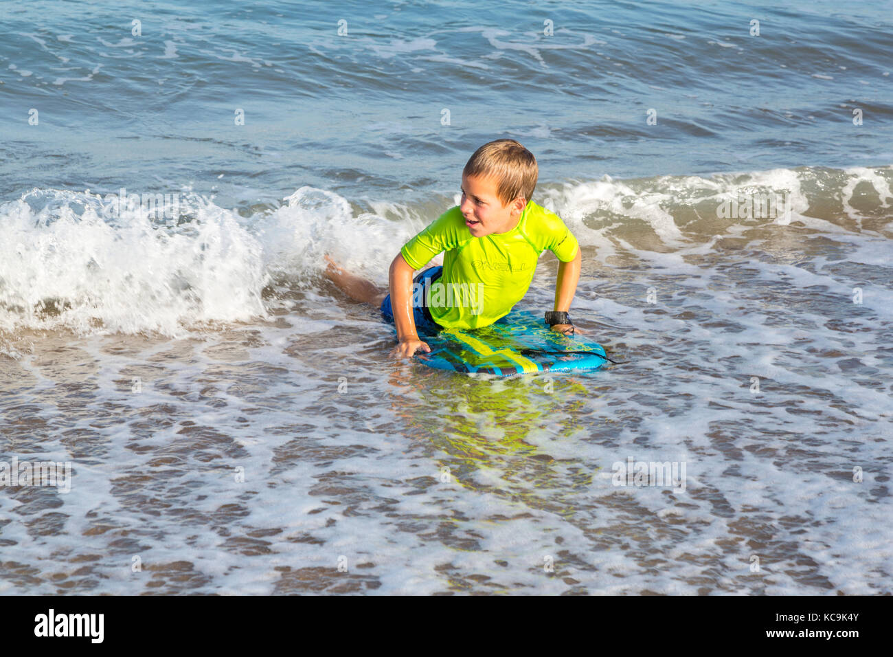 Avon, Outer Banks, North Carolina, USA.  Young Boy with his Boogie Board Landing on the Beach. - Stock Image