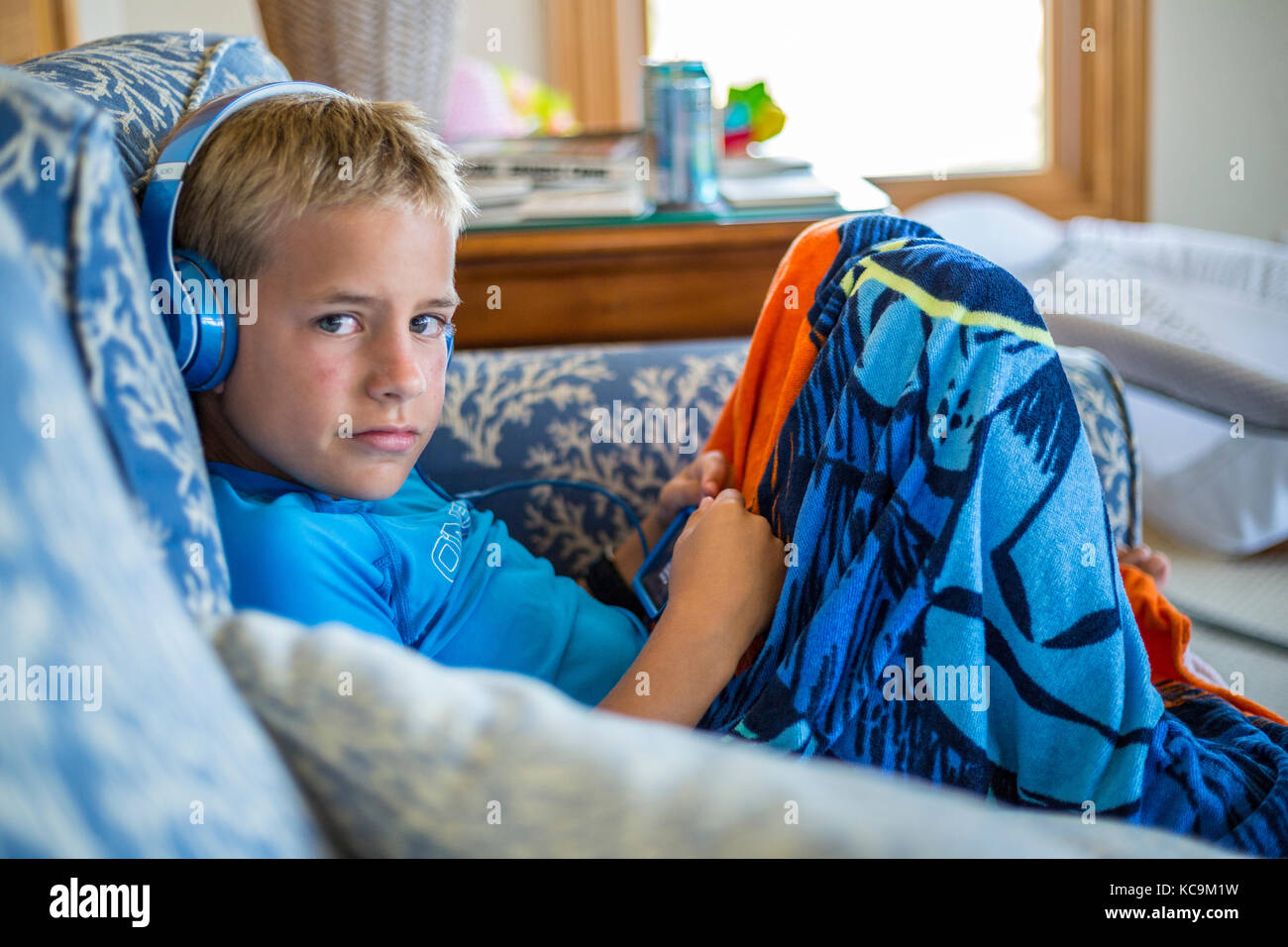 Avon, Outer Banks, North Carolina, USA.  Young American Boy with his Mobile Gaming Device. - Stock Image
