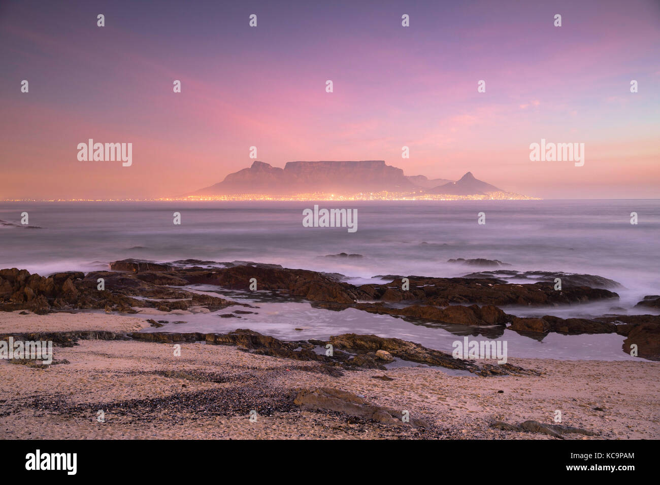 View of Table Mountain from Bloubergstrand at sunset, Cape Town, Western Cape, South Africa - Stock Image