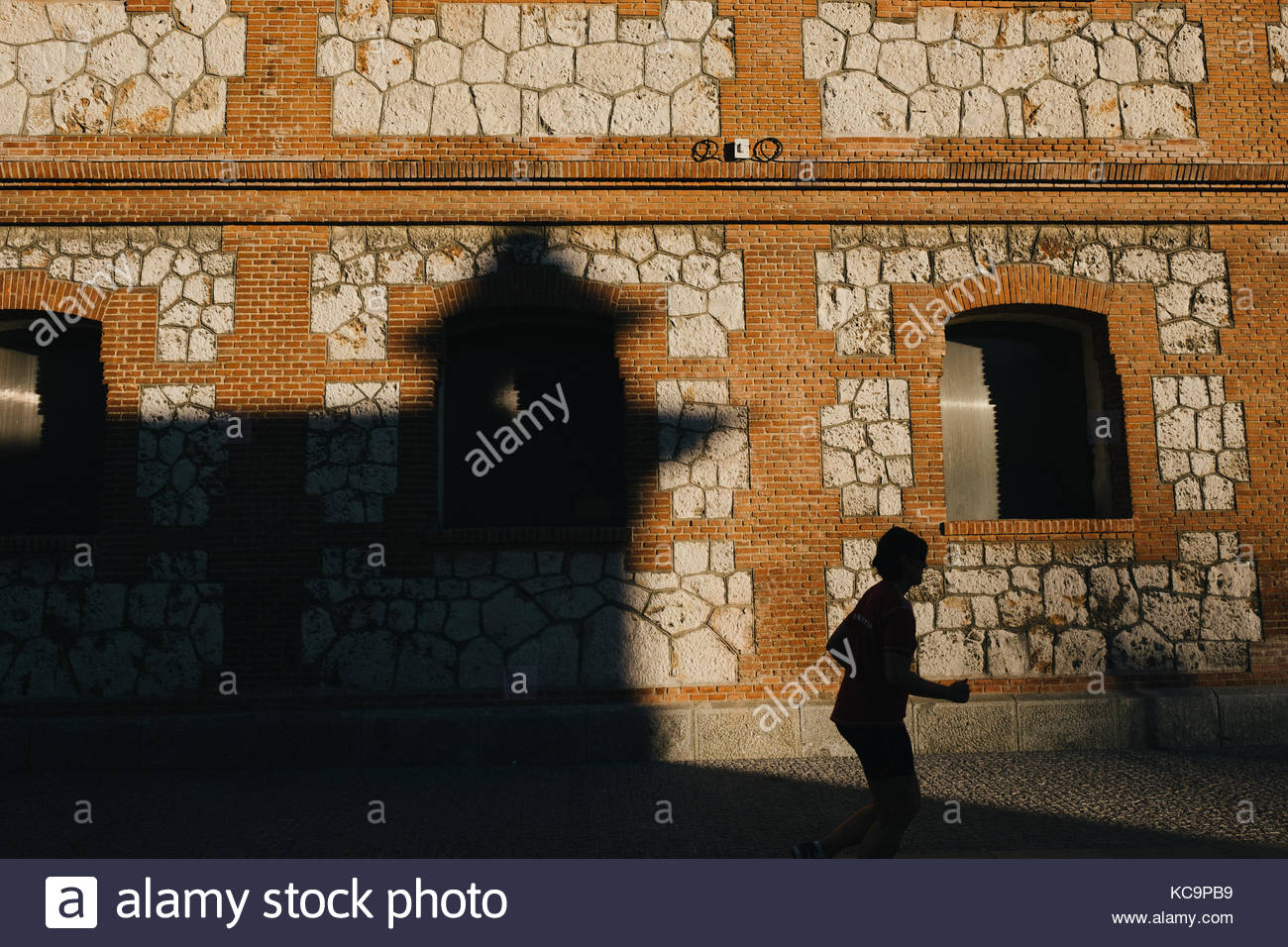 runner on the shadow - Stock Image