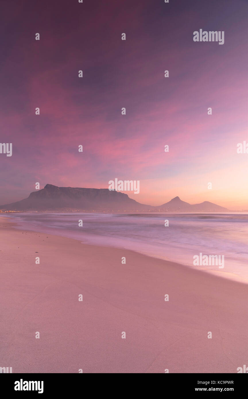 View of Table Mountain from Milnerton beach at sunset, Cape Town, Western Cape, South Africa - Stock Image