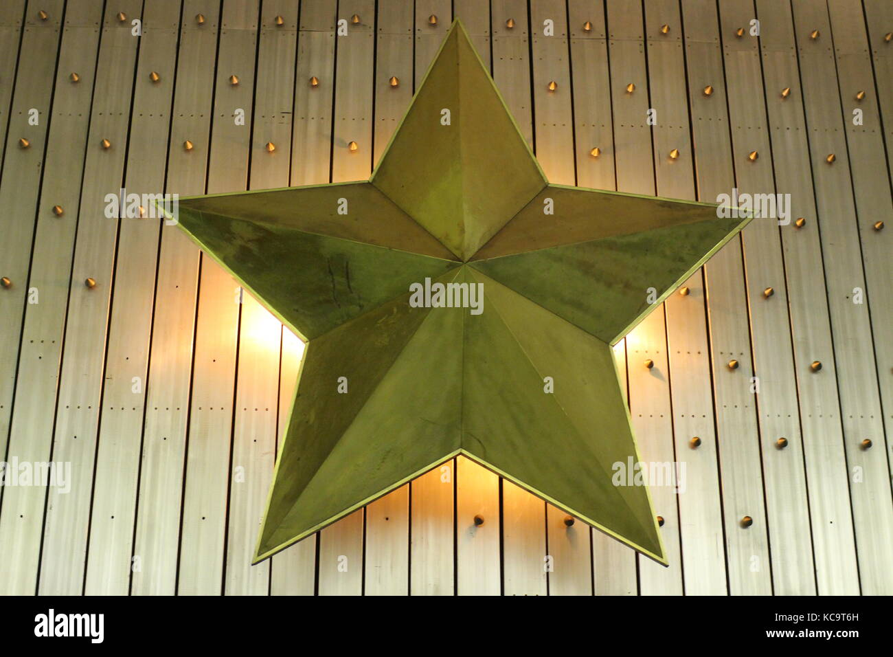 five-pointed star decorative wall lamp, Soviet symbols in art - Stock Image