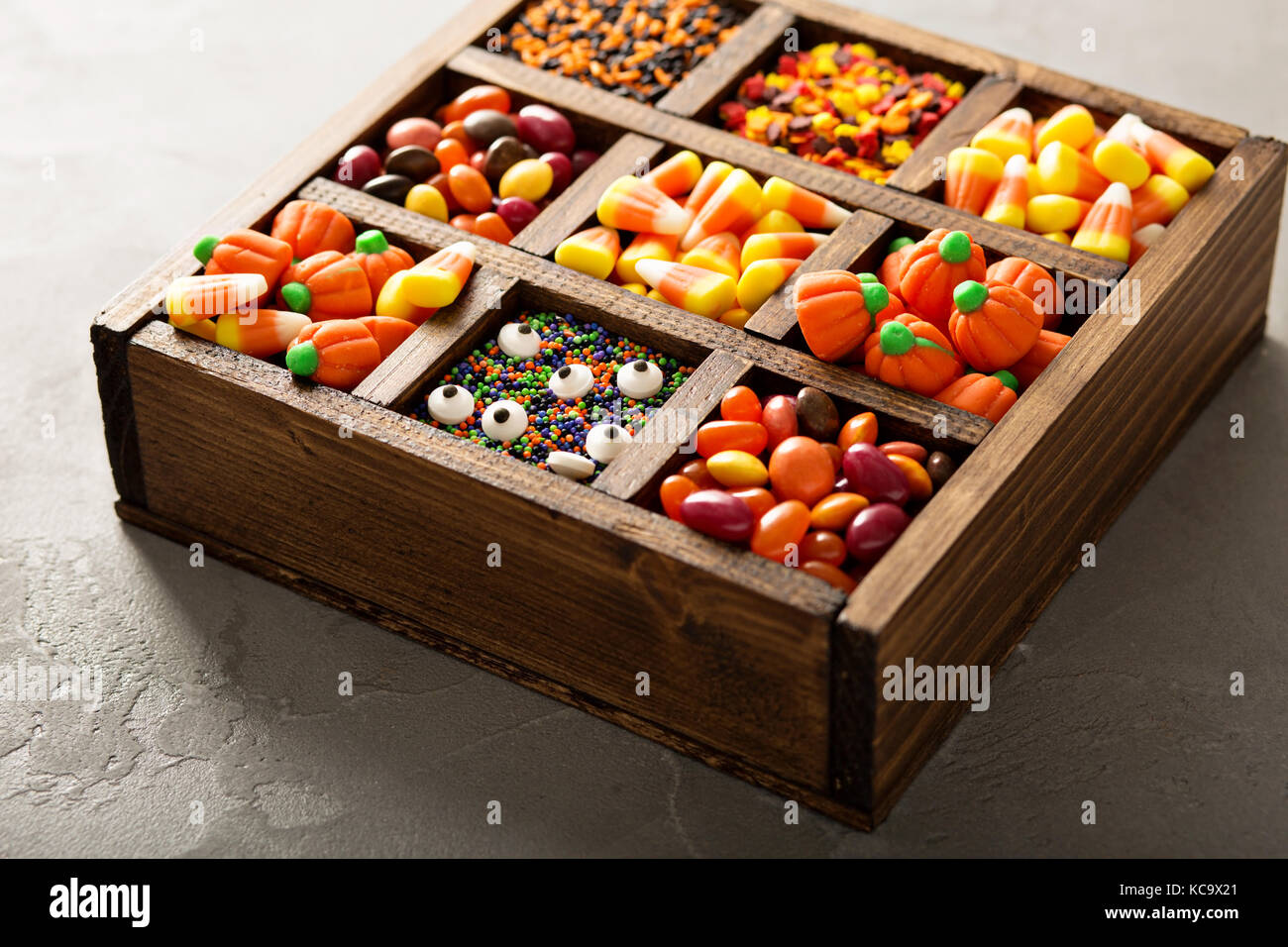 Halloween candy in a wooden box - Stock Image