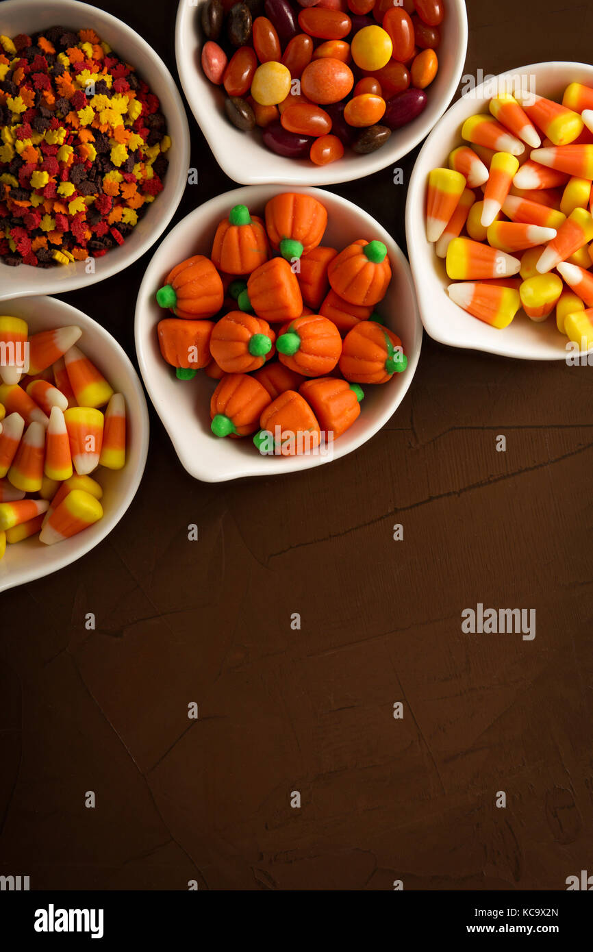 Halloween candy in white bowls - Stock Image
