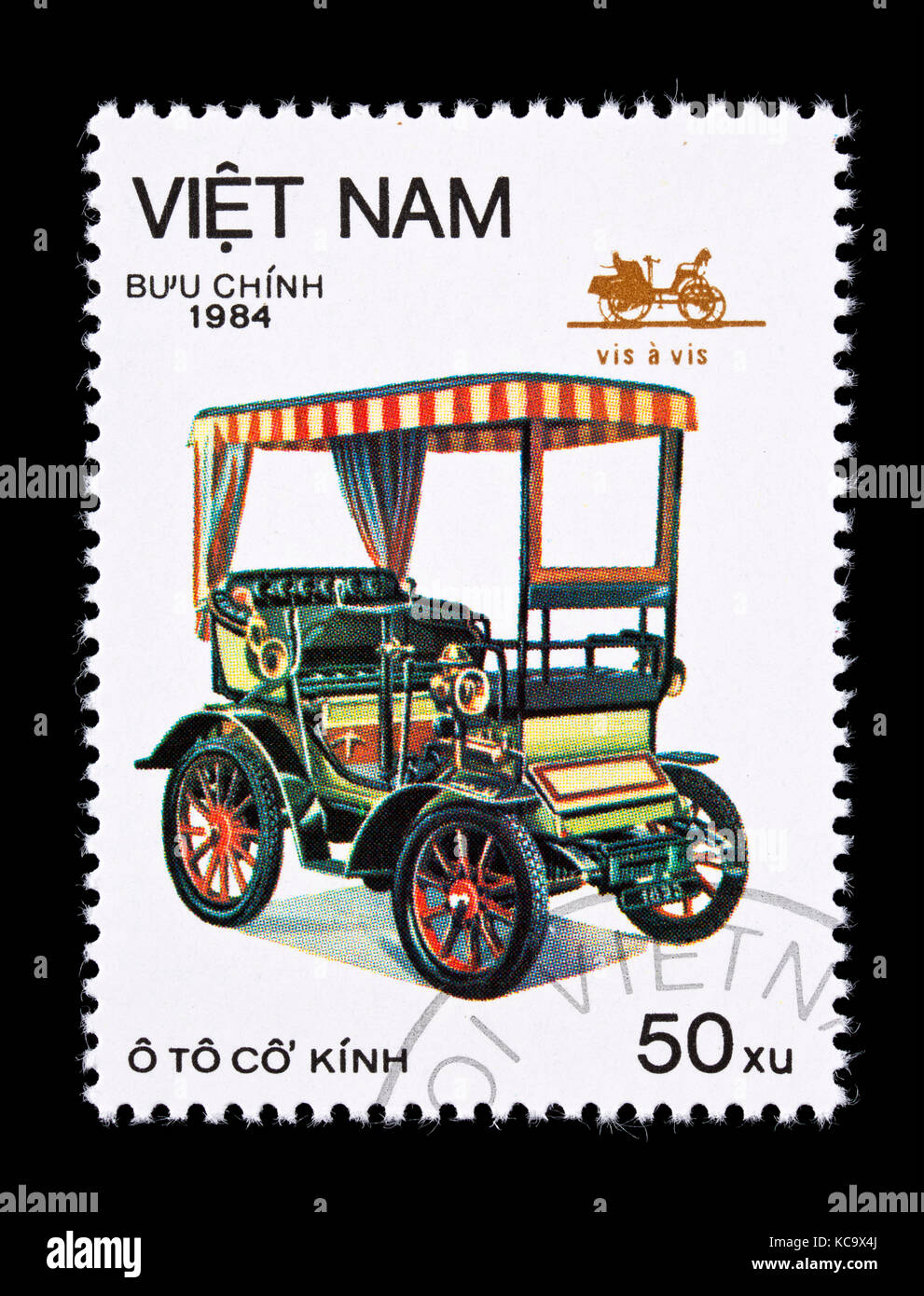Postage stamp from Vietnam depicting a vis a vis, classic automobile. - Stock Image