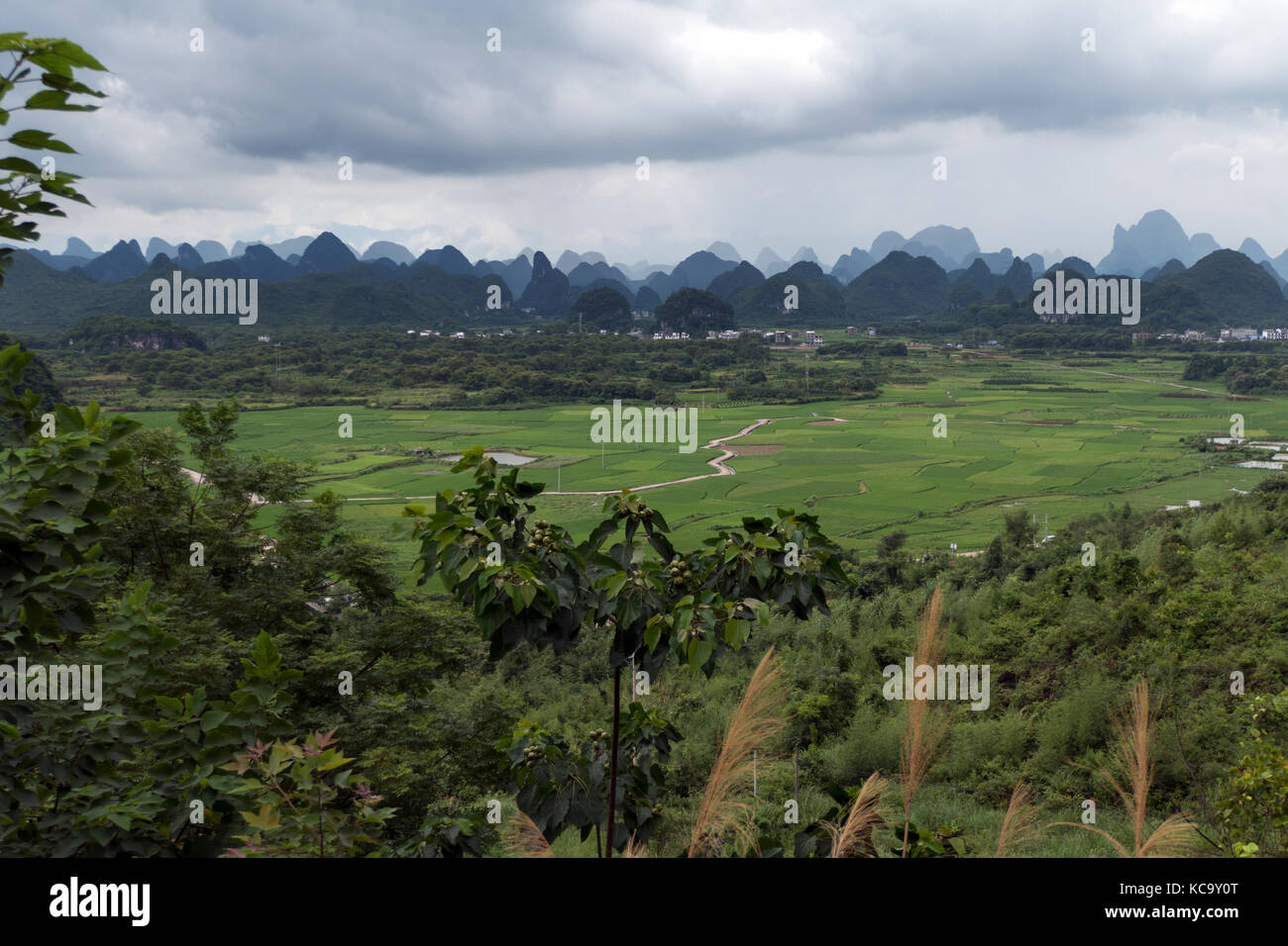 Beautiful Chinese natural landscape with karst hills, green mountains, small village, countryside between Yangshuo Stock Photo