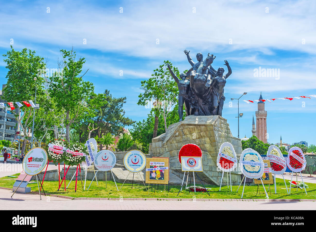 ANTALYA, TURKEY - MAY 12, 2017: The Ataturk monument in Republic Square is decorated with wreathes and info boards - Stock Image