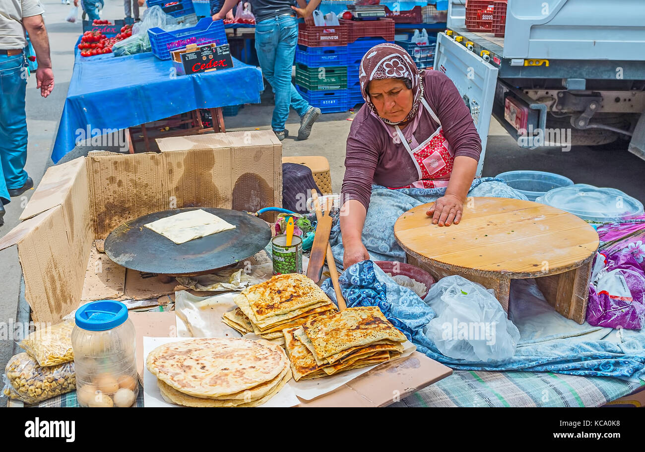 Antalya Turkey May 12 2017 The Street Kitchen In Muratpasa Friday Market With The Cook Preparing Gozleme Turkish Flatbread With Fillings On M Stock Photo Alamy