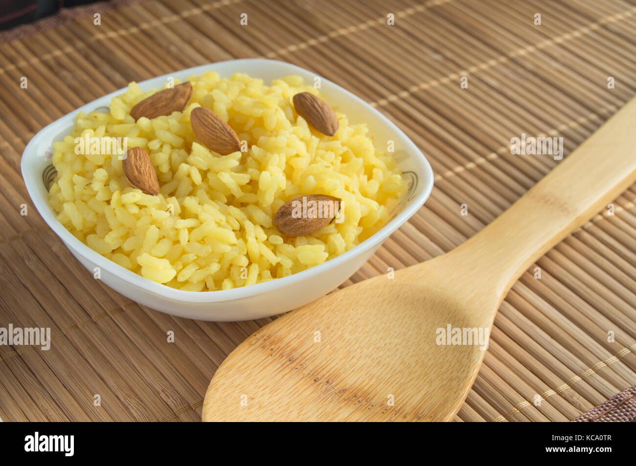 Traditional Indian Pongal, Makar Sankranti rice nuts almonds. - Stock Image