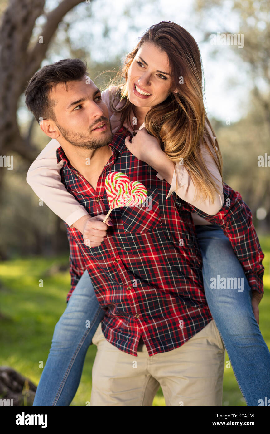 Portrait of a happy young couple in the nature hugged together - Stock Image