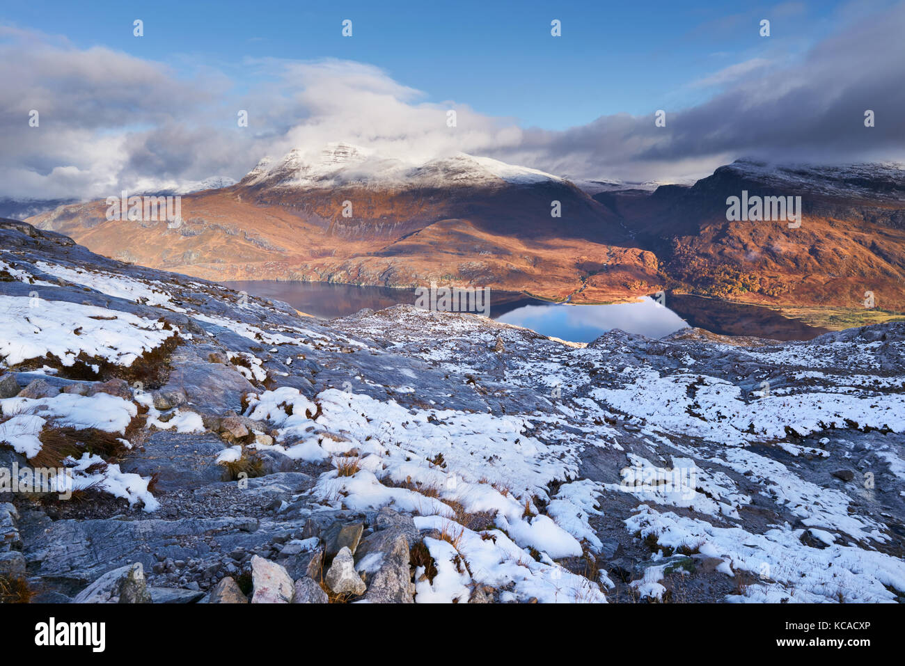 The summits of Slioch and Beinn a Mhuinidh over Loch Maree in the Scottish Highlands, Scotland, UK. - Stock Image